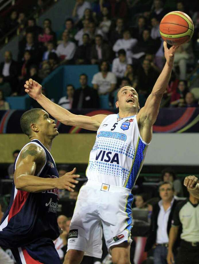 Argentina's Manu Ginobili, right, goes to the basket over Panama's Ruben Garces during a FIBA Americas Championship basketball game in Mar del Plata, Argentina, Saturday Sept. 3, 2011. The top two finishers of the tournament get an automatic berth in the 2012 London Olympics and the next three advance to the last-chance Olympic qualifier to be held in July 2012. Photo: Martin Mejia/Associated Press