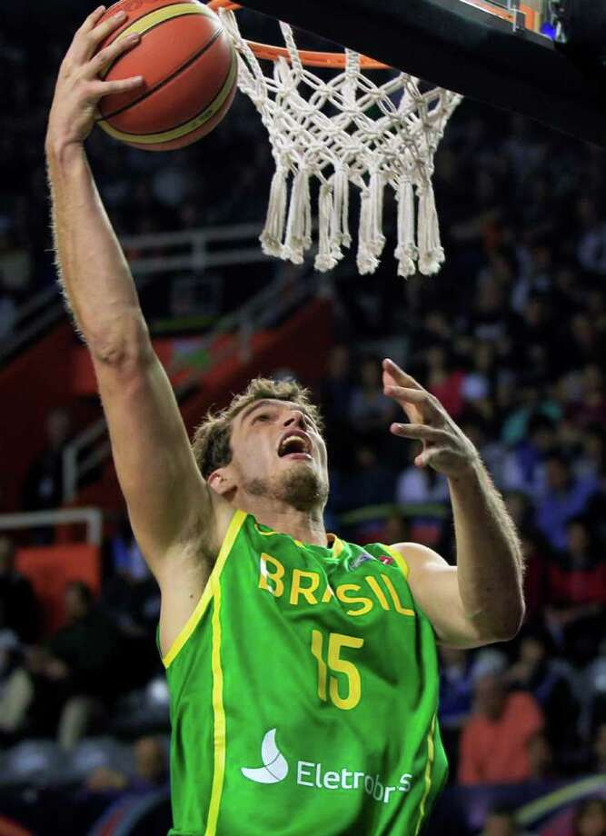 Brazil's Tiago Splitter goes up for a shot during a FIBA Americas Championship basketball game against Cuba in Mar del Plata, Argentina, Saturday Sept. 3, 2011. The top two finishers of the tournament get an automatic berth in the 2012 London Olympics and the next three advance to the last-chance Olympic qualifier to be held in July 2012. Photo: Martin Mejia/Associated Press