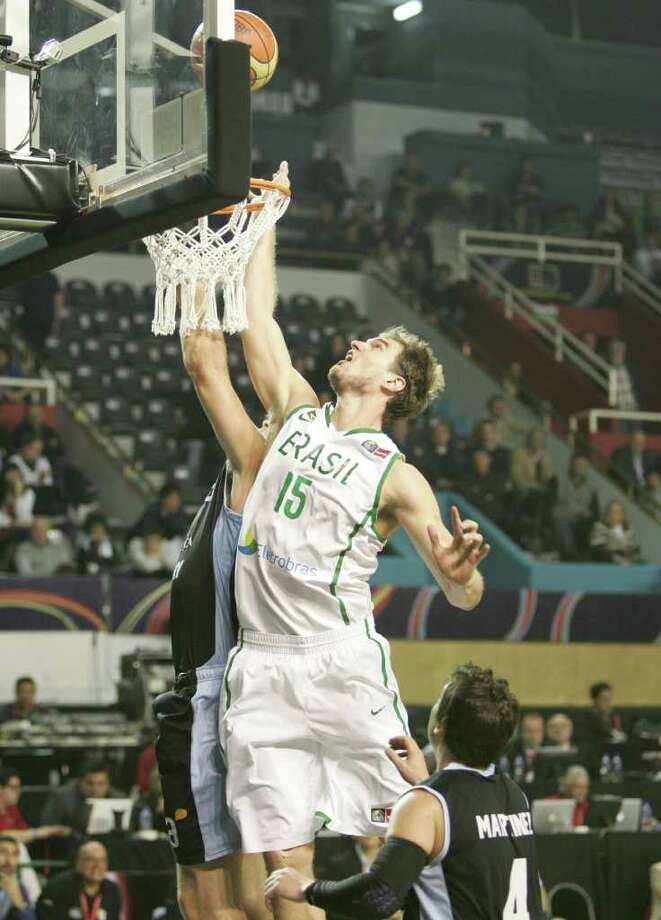 Brazil's Tiago Splitter battles for the ball against Uruguay during a FIBA Americas Championship basketball game in Mar del Plata, Argentina, Monday, Sept. 5, 2011. Photo: Jose Jimenez/FIBA Americas / © FIBA Americas 2011