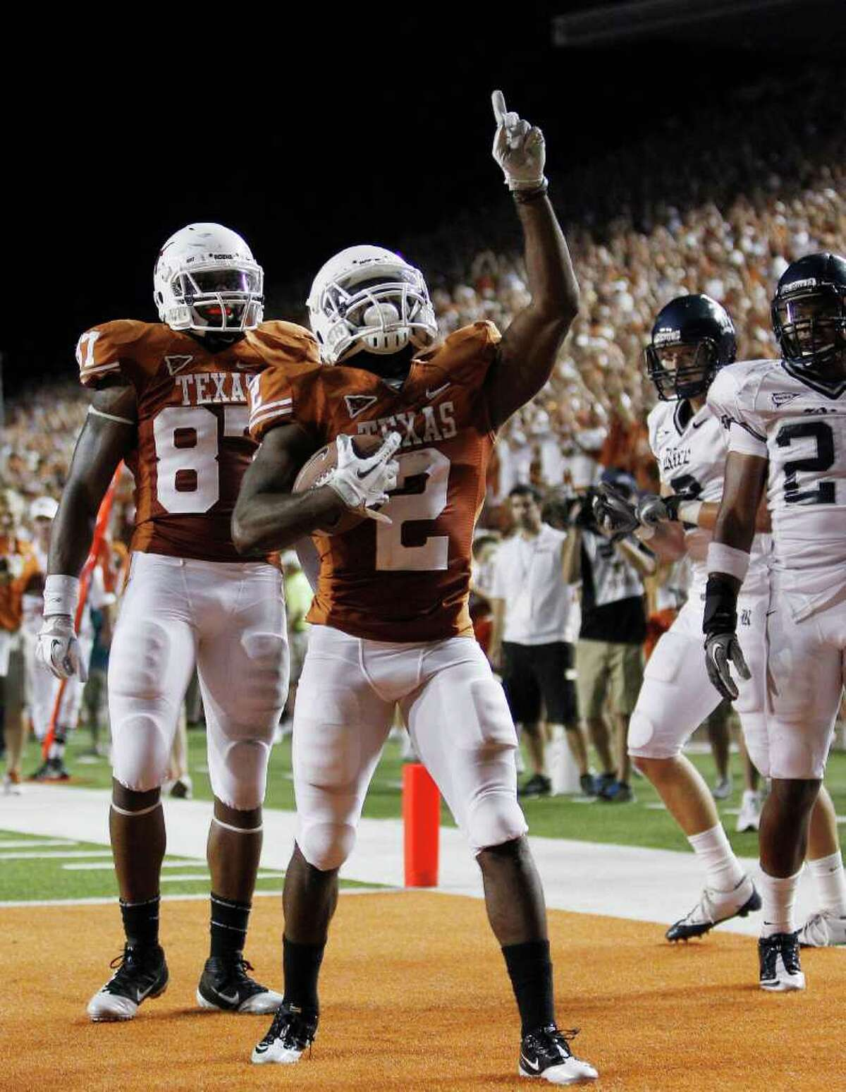 UT running back Fozzy Whittaker (2) celebrates after scoring a touchdown during the fourth quarter Saturday vs. Rice.