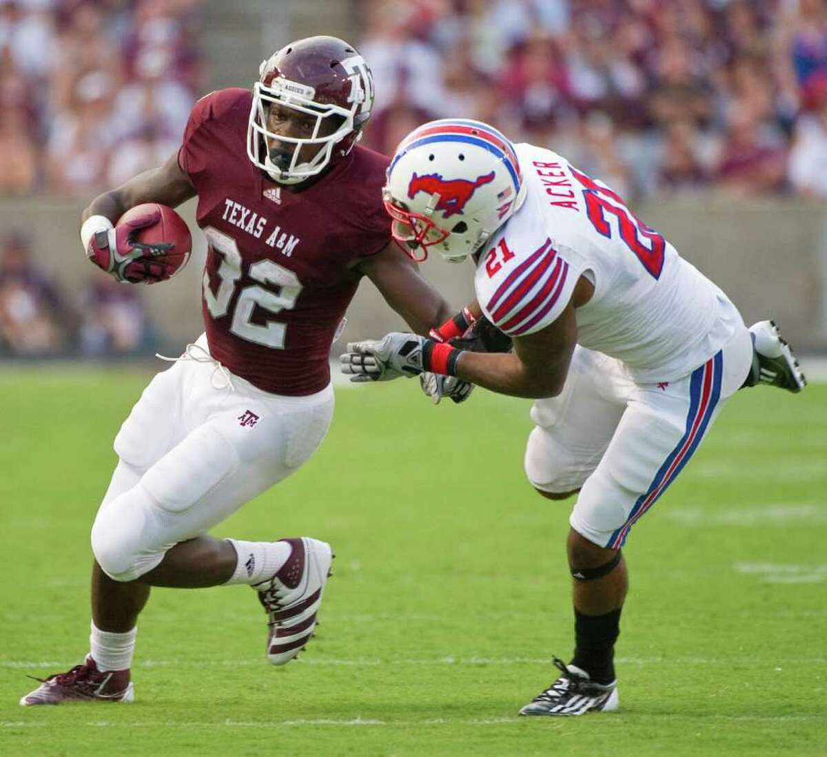 Texas A&M's Cyrus Gray (left) fends off SMU's Kenneth Acker during Sunday's 132-yard outing.