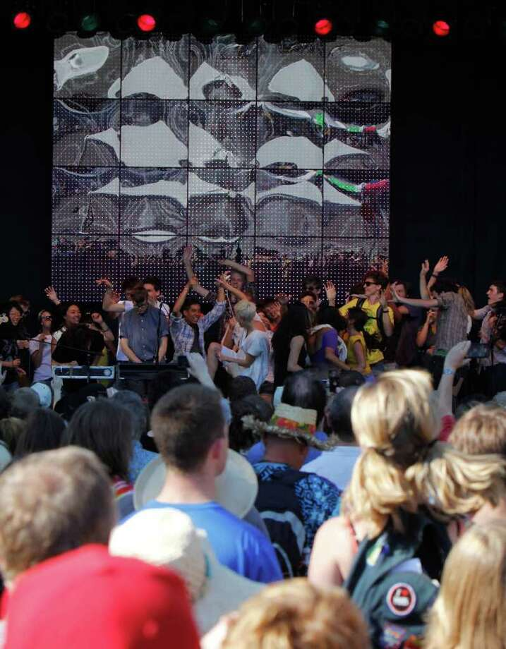 The band YACHT invited fans to dance on the stage with them during a song at Bumbershoot. Photo: JOE DYER / SEATTLEPI.COM