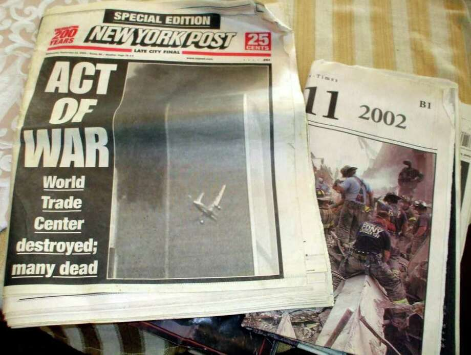 Fred Suarez of Danbury kept these newspapers as a reminder of the terrible events and the lives lost on Sept. 11, 2001. Suarez, 44, worked in lower Manhattan at the time of the terrorist attacks 10 years ago. Photo: Brian Koonz