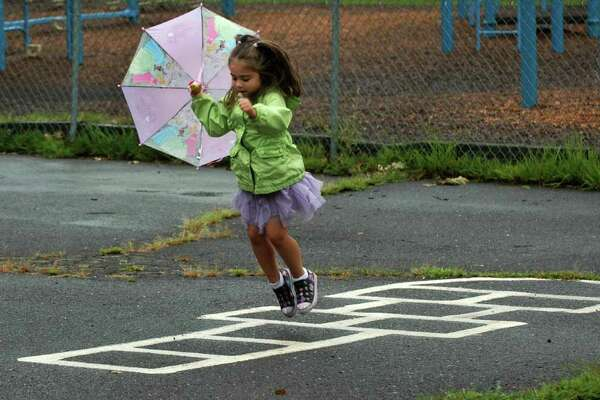 Kindergarten student Sofia Destaso plays hopscotch at the Roger Sherman School playground before the first day of school in Fairfield Conn. on Tuesday Sept. 6, 2011.