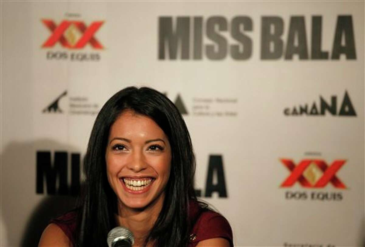 """Mexican actress Stephanie Sigman smiles during a press conference to promote """"Miss Bala"""" film in Mexico City, Monday, Sept. 5, 2011. Miss Bala will be released on Sep. 9 in Mexico. (AP Photo/Eduardo Verdugo)"""