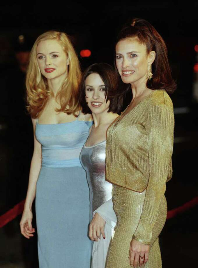 """Lacey Chabert, center, was 12 when she started her role as Claudia on """"Party of Five."""" She was 16 when this photo with Heather Graham and Mimi Rogers was taken after Chabert played Penny Robinson in """"Lost in Space."""" Chabert also did voiceover work for several TV shows before she was 18, including """"The Wild Thornberrys"""" and """"Family Guy."""" Photo: Chris Pizzello, STR"""