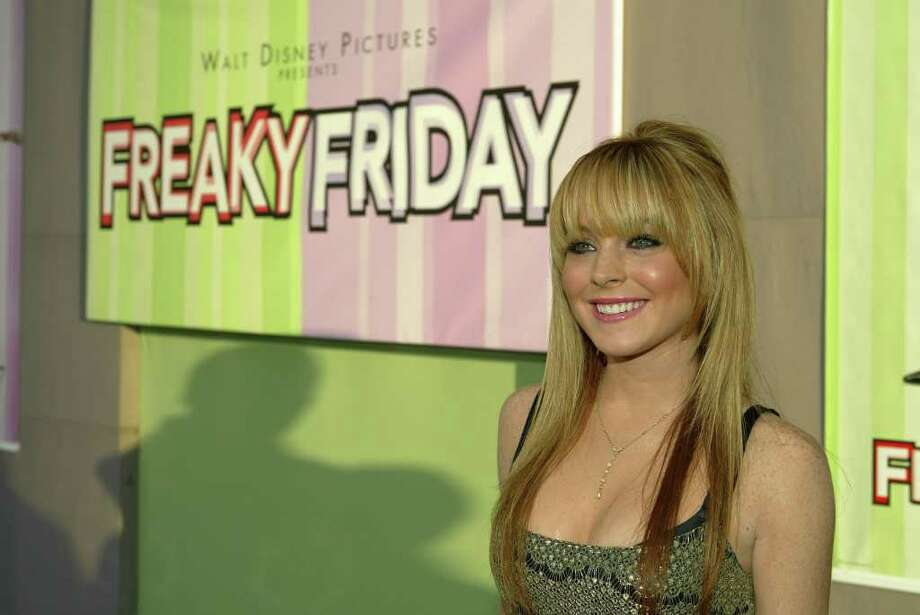 """Lindsay Lohan's first big movie was as twins in 1998's """"The Parent Trap,"""" when Lohan was 12 years old. She then starred in a few Disney TV movies, including """"Life-Size"""" and """"Get a Clue,"""" before she played opposite Jamie Lee Curtis in """"Freaky Friday"""" when she was 17. Photo: ERIC CHARBONNEAU/BEIMAGES, HO / AP2003"""