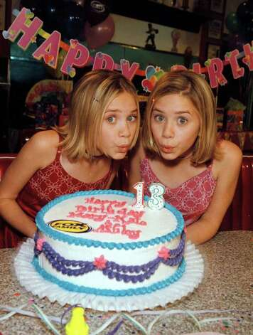 "The Olsen twins, Mary-Kate, left, and Ashley, weren't even a year old when they shared the role of Michelle Tanner on ""Full House."" From there, the twins, 13 in this photo, appeared in many films and had their own TV show, ""Two of a Kind,"" at 13.  Photo: CRAIG T. MATHEW, HO / AP1999"