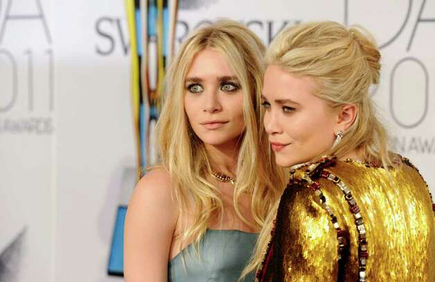 "Ashley, left, and Mary-Kate Olsen, now 25, are billionaires and more into fashion than acting, though Mary-Kate has been seen on ""Weeds"" and in the 2011 film ""Beastly."" They have a clothing line at Wal-Mart stores and a couture fashion label called ""The Row."" Photo: Peter Kramer, FRE"