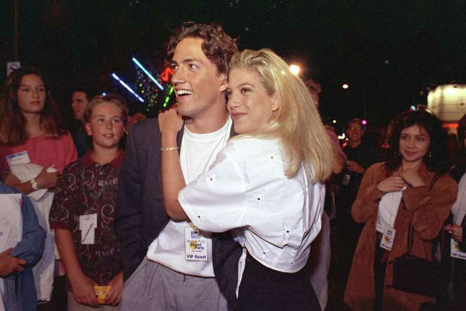 "Tori Spelling was 19 when this photo was taken with ""Melrose Place"" star Andrew Shue, but before ""Beverly Hills, 90210,"" Spelling was appearing on various TV shows, including ""Vega$"" at the age of 8 and ""Fantasy Island"" in 1983, when she was 10. She also appeared on ""Saved by the Bell"" in 1990 at age 17, the same year and age as when she was cast on the long-running ""Beverly Hills, 90210."" Photo: KEVORK DJANSEZIAN, STF / AP1992"