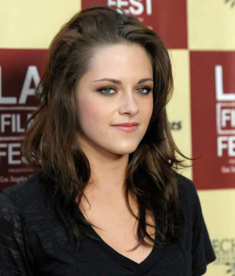 "In addition to ""Twilight,"" Stewart, 21, played Joan Jett in 2010's ""The Runaways"" with Dakota Fanning, and will be seen in 2011's ""On the Road."" She also will play Snow White in one of two Snow White films due out in 2012, ""Snow White and the Huntsman"" with Chris Hemsworth and Charlize Theron. Photo: Dan Steinberg, FRE"