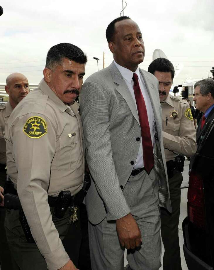 TO GO WITH AFP STORY ENTERTAINMENT-US-MUSIC-JACKSON-TRIAL by Michael Thurston (FILES) Singer Michael Jackson's doctor Conrad Murray arrives at the Los Angeles Airport Courthouse in this February 8, 2010 file photo. Jury selection will begin this week for the long-awaited trial of Michael Jackson's doctor, accused of manslaughter over the pop icon's shock 2009 death at the age of 50. The Los Angeles Superior Court will begin vetting potential jurors September 8, 2011, ahead of the trial starting later this month of Conrad Murray, accused of killing Jackson with an overdose of a powerful sedative.  AFP PHOTO/ GABRIEL BOUYS/ FILES (Photo credit should read GABRIEL BOUYS/AFP/Getty Images) Photo: GABRIEL BOUYS, Staff / AFP