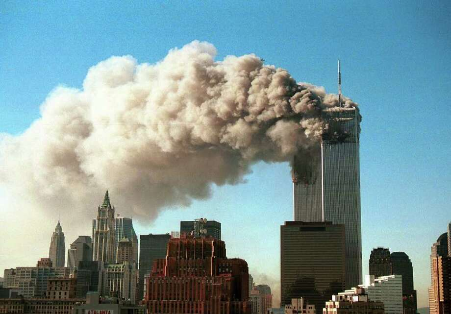 TERRORIST ATTACKS: Smoke pours from the twin towers of the World Trade Center after they were hit by two hijacked airliners in a terrorist attack Sept. 11, 2001, in New York City. Photo: Robert Giroux, Staff / 2011 Getty Images