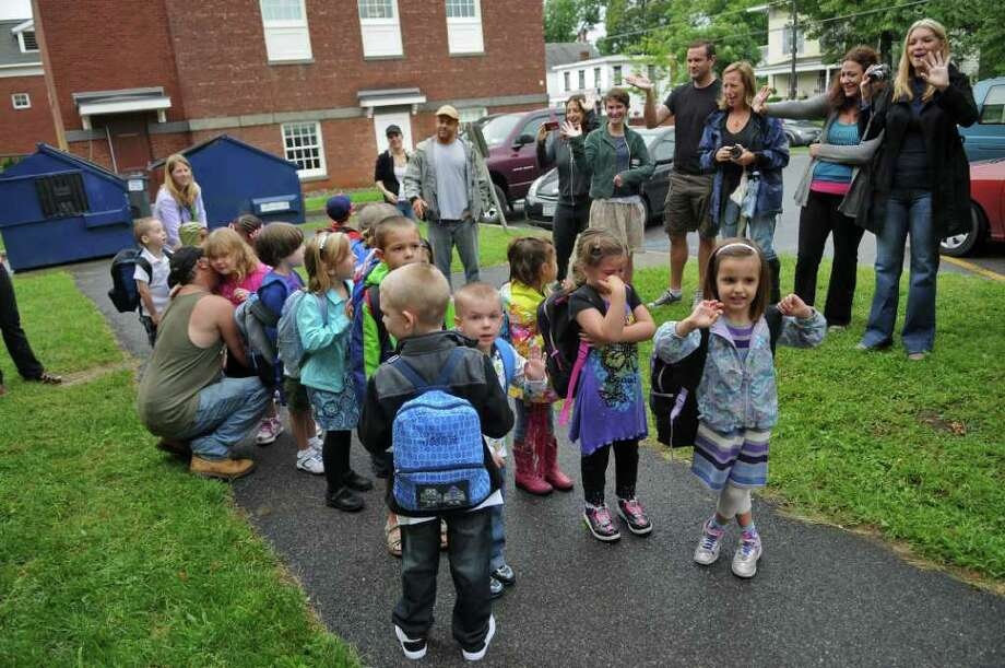 Parents wave goodbye as their children  head to kindergarten Tuesday morning on the first day of school at Cahill Elementary in Saugerties.  ( Philip Kamrass / Times Union) Photo: Philip Kamrass