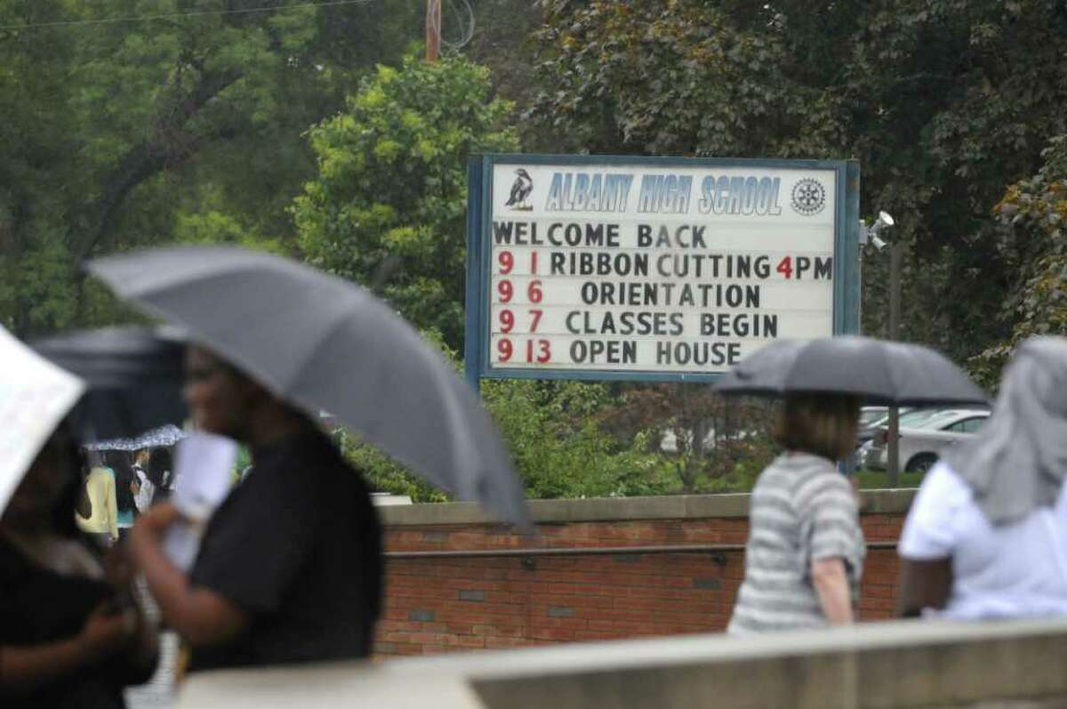 Students and staff Tuesday make their way in and out of Albany High School during Orientation Day. (Paul Buckowski / Times Union)