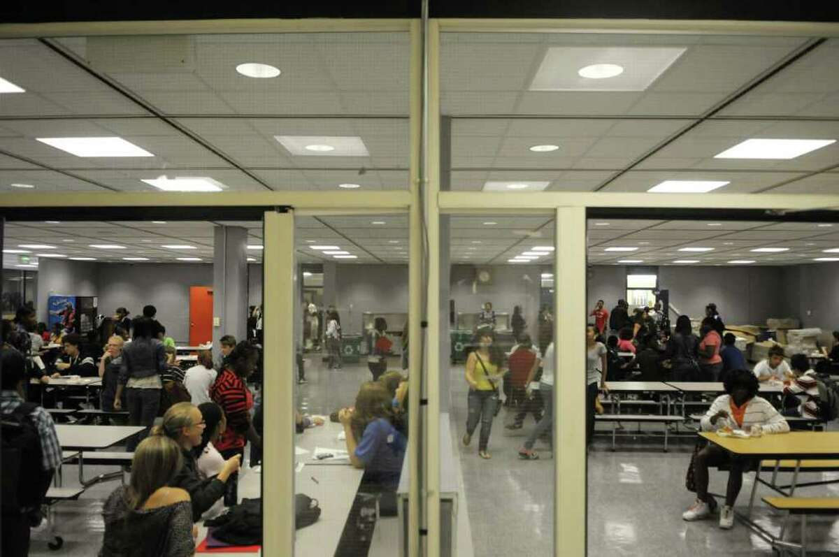 Students eat lunch in the cafeteria Tuesday during orientation at Albany High School. (Paul Buckowski / Times Union)