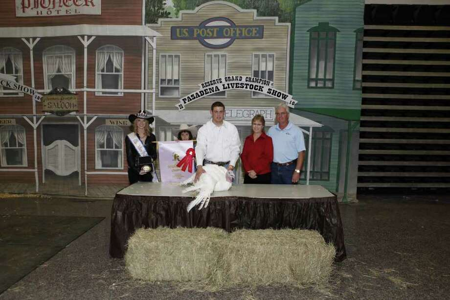 BIG WINNER: Miss Pasadena Rodeo 2010, left, celebrates Darrin Miller's 2010 award for the reserve champion Turkey Tom at the 2010 livestock show and rodeo, with officials from Oates Industries. Oates Industries purchased the turkey. Photo: PHOTOS COURTESY DIAMOND O PHOTOG