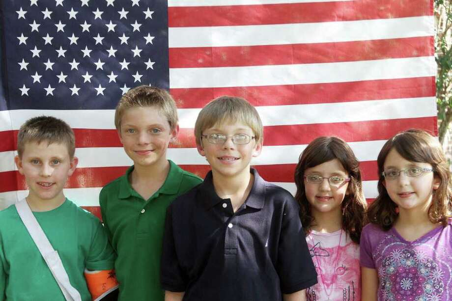 PIN LIM: FOR THE CHRONICLE YOUNG PATRIOTS: Clear Lake-area children who were born in 2001, from left, Leo Donato, Brandon Falknor, Travis Falknor, Julia Adams and Emily Adams said they understand what happened on Sept. 11, 2001, and they won't forget. Photo: Pin Lim, Freelance / Copyright Pin Lim.
