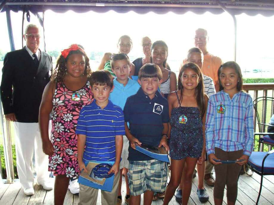 The Young Mariners Class of 2011, with certificates and awards, gather at the Riverside Yacht Club. Front row from left:  Marvin Campos, Michael Rincon, Alyzah Rumboao, and Mia Binuya. Second row from left: Angelique Keys, Kyle Kelly, Bianca Petate and Kevin Wing. Back row from left: Riverside Yacht Club Commodore Walton Alder, Sophia Daoud, Dawn Berrocal, aquatic director Boys & Girls Club of Greenwich, and Tom O'Connell, founder of the Greenwich Young Mariners Foundation. Not visible in the back row, Diego Sanchez. Photo: Contributed Photo