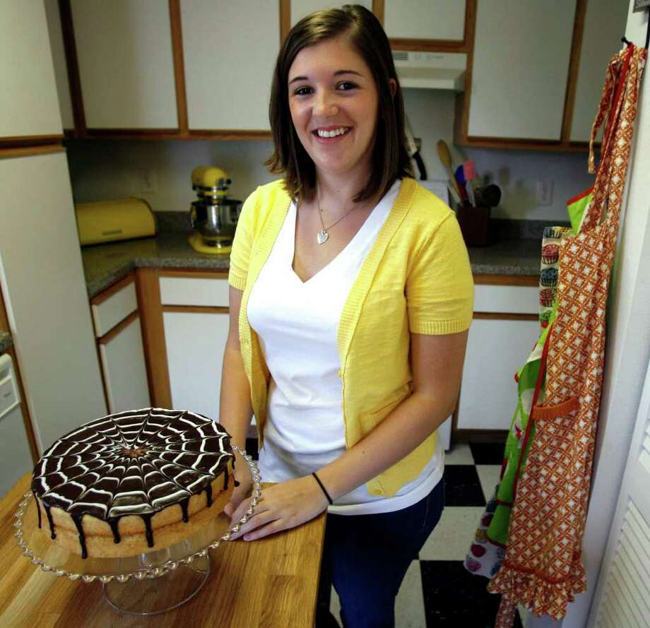 Carrie Goad displays her Boston cream pie. The Cottage Food Law lets her build her client base before opening a coffee shop or bakery. Photo: OMAR PEREZ, San Antonio Express-News / SAN ANTONIO EXPRESS-NEWS