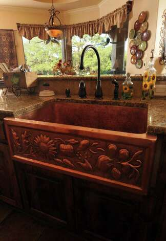 A copper sink gleams with warmth in the Novoas' kitchen. Photo: Photo By Robin Jerstad/Special To The Express-News / Copyright 2011 by Robin Jerstad