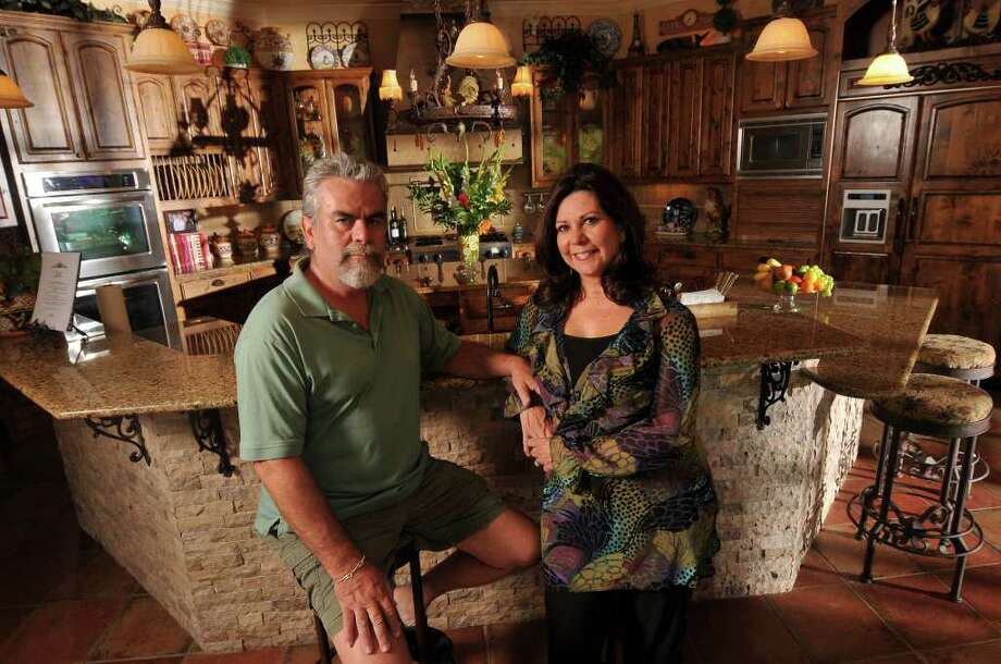 Paco and Denise Novoa designed their Fair Oaks Ranch kitchen to accommodate a crowd, as well as more than one cook. Photo: Photo By Robin Jerstad/Special To The Express-News / Copyright 2011 by Robin Jerstad