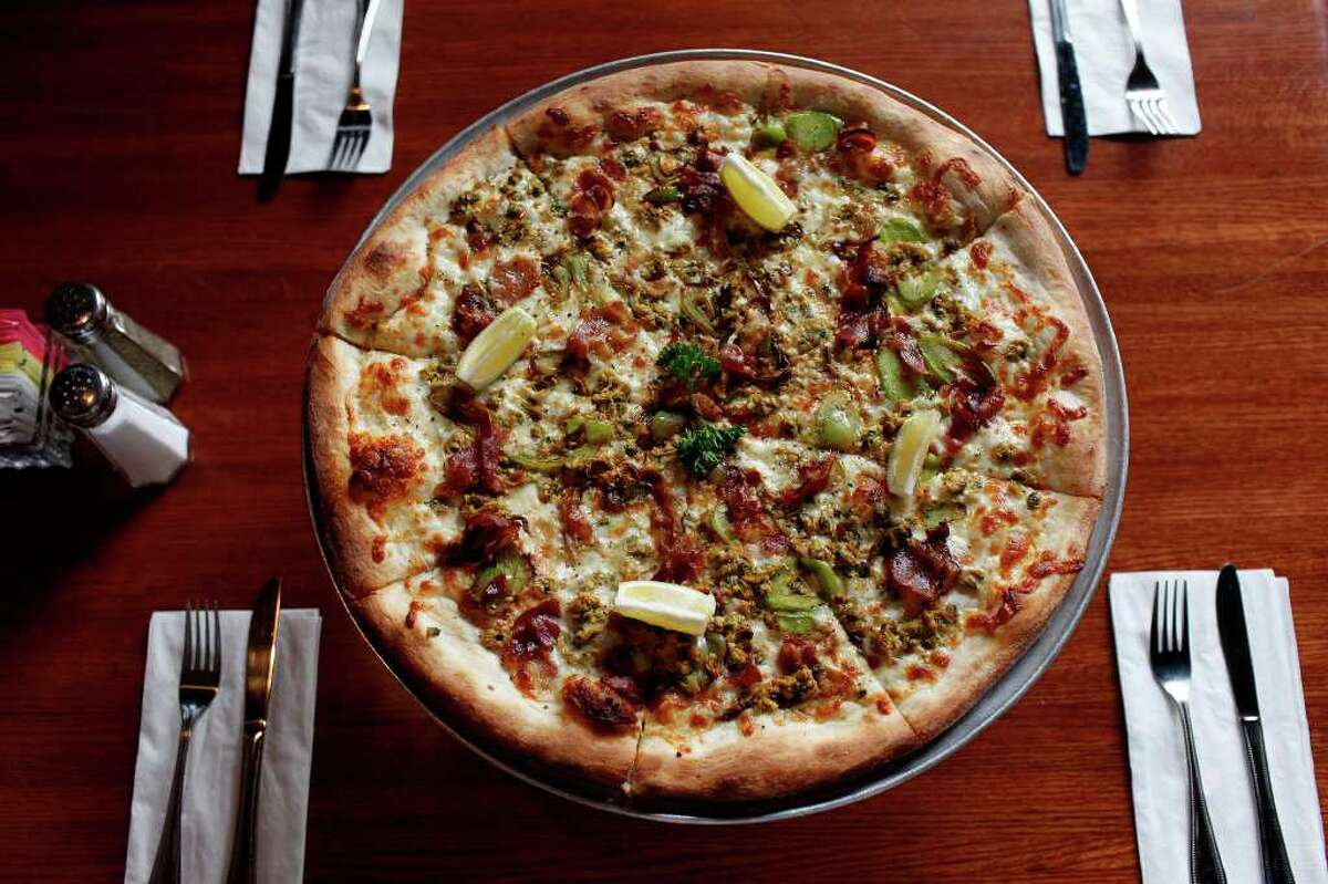 One of Naples Pizza's specialty pizzas is the clams casino, which includes bacon, garlic and diced green peppers.