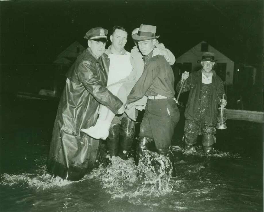 A Greenwich citizen is rescued by first responders from another time during the Hurricane of 1938. Photo: Contributed Photo