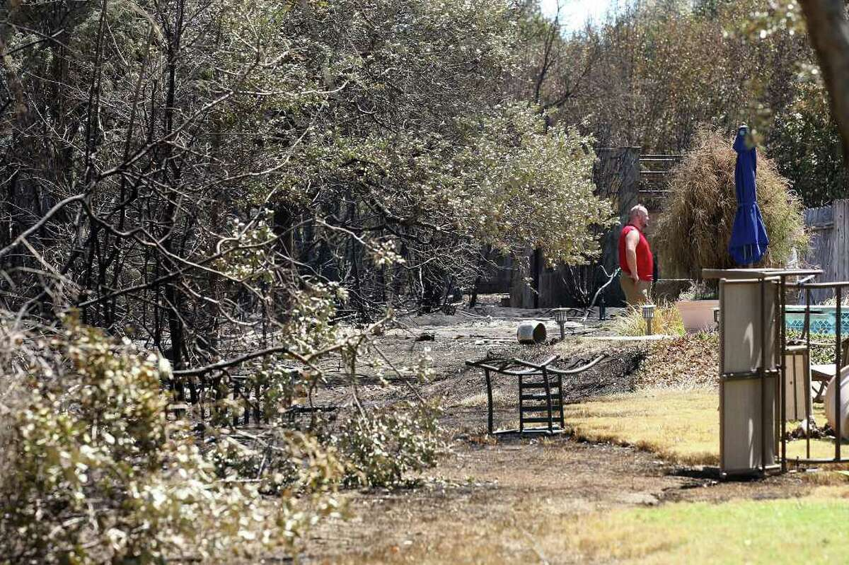 The fire line stopped just short of residences in some parts of the Steiner Ranch subdivision in western Travis County, Tuesday, Sept. 6, 2011. The 125-acres fire destroyed 24 homes and damaged 30 and is 45 percent contained according to the Austin American-Statesman.