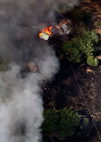 A structures burned Tuesday Sept. 6, 2011 as seen in this aerial image over the wildfires in the Bastrop, Texas. Photo: WILLIAM LUTHER, William Luther/wluther@express-news.net / 2011 SAN ANTONIO EXPRESS-NEWS