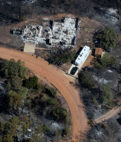 A home destroyed by wildfires is seen Tuesday Sept. 6, 2011 in this aerial image over the wildfires in the Bastrop, Texas. Photo: WILLIAM LUTHER, William Luther/wluther@express-news.net / 2011 SAN ANTONIO EXPRESS-NEWS