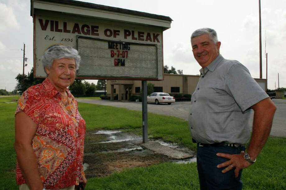 Margie Krenek (cq), mayor of Pleak and Tom Stavinoha (cq), Fort Bend County Commissioner talk about changing times, Friday, outside the Pleak municipal building located on the site of his family's former farm. South of Rosenberg about 5 miles on Highway 36, Pleak is being transformed from a predominately agrarian community to a growing residential development.  Friday, Aug. 3, 2007, in Pleak. (Steve Ueckert / Chronicle) Photo: Steve Ueckert, Staff / Houston Chronicle
