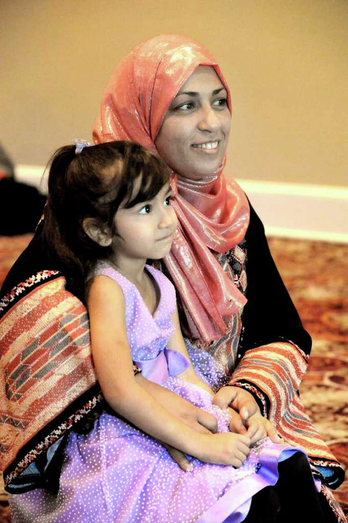 Eman Beshtawii, of Newtown, pictured with her daughter Mariam, says that the 9/11 attacks broke her heart. She cannot accept people hurting one another, she said.