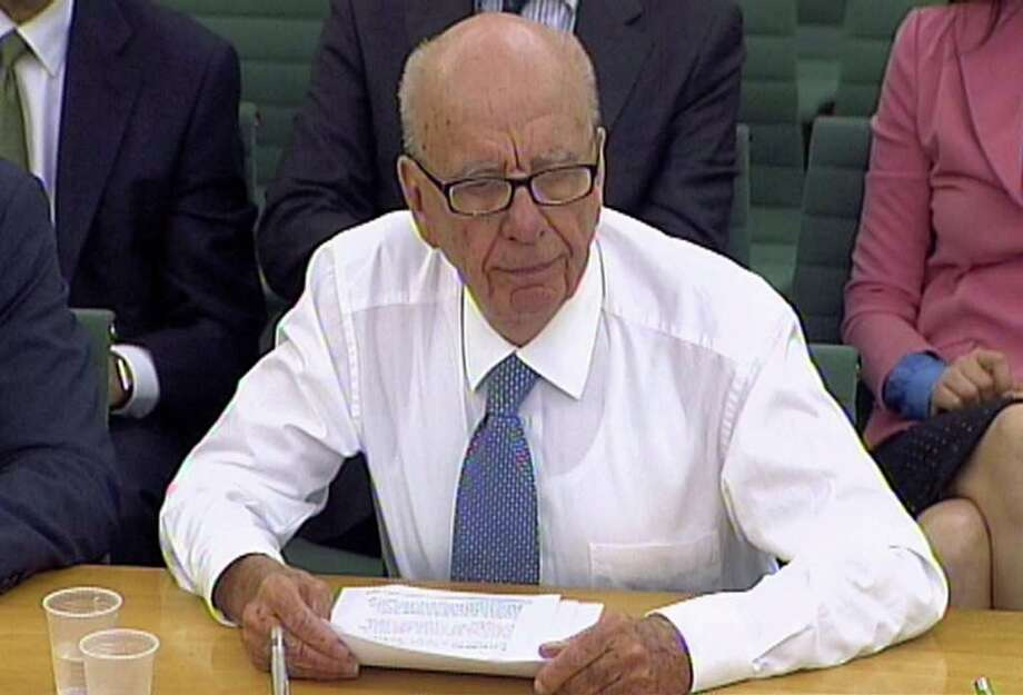 In this image made from television, Rupert Murdoch, following an attempted assault, gives evidence without his jacket  to a House of Commons Committe on the News of the World phone-hacking scandal.(AP Photo/pa) UNITED KINGDOM OUT: NO SALES: NO ARCHIVE: Photo: PA, SUB / AP2011