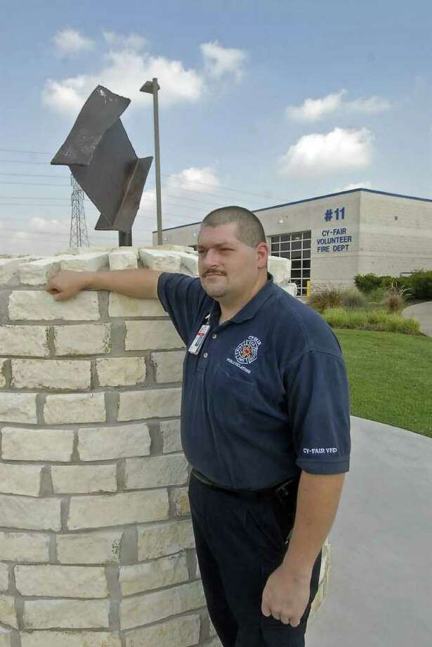 TONY BULLARD: FOR THE CHRONICLE DEDICATION: Cy-Fair Volunteer Fire Department firefighter Robert Rasa has been working on a 9/11 memorial at Station 11,  which includes metal from the World Trade Center. For more information, call the department at 281-550-6663. Photo: Tony Bullard / Credit: for the Chronicle
