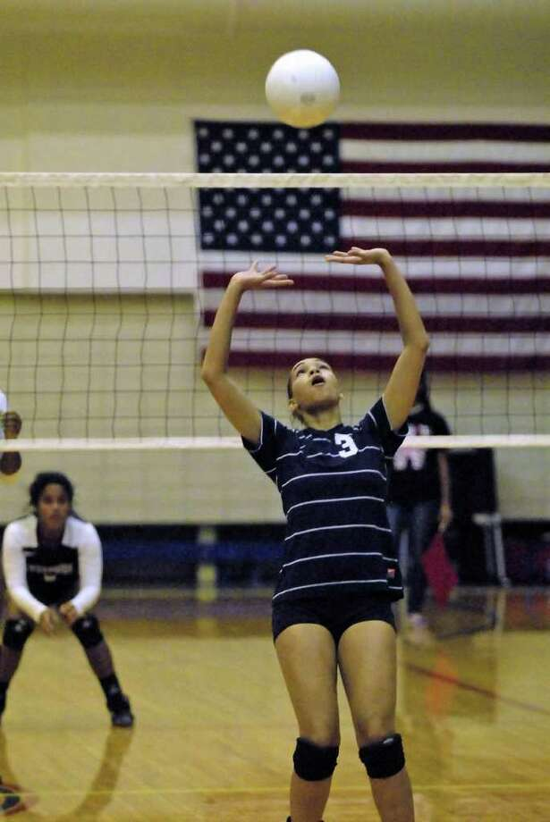 Morgan Thomas (#3) sets the ball for Lamar during their game with Westside Tuesday 8/30/11 at Butler Fieldhouse. Photo by Tony Bullard. Photo: Tony Bullard / Credit: for the Chronicle