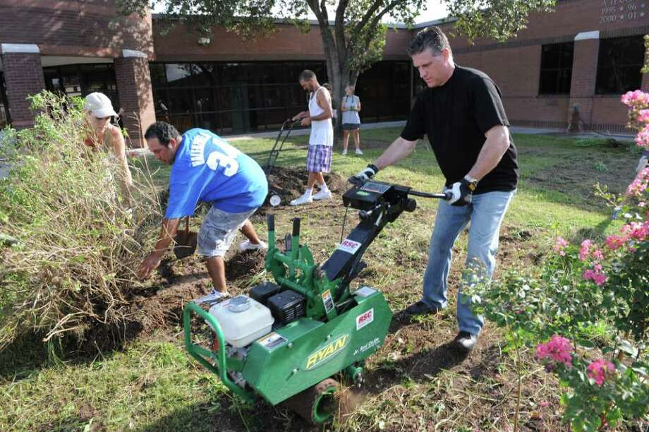 PROJECT ORGANIZER: Dennis Eck, operates a rotor tiller machine during the campus beautification project at Hairgrove Elementary. Photo: Thomas Nguyen, Freelance / Freelance
