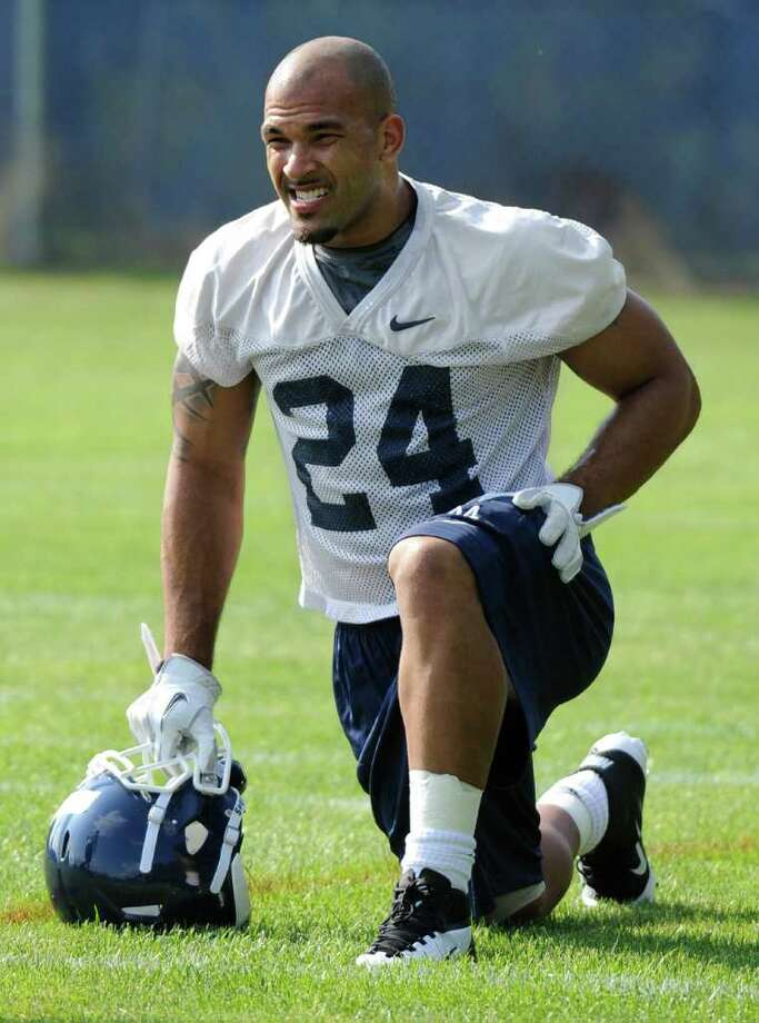 Connecticut running back D.J. Shoemate grabs a breather during the first day of practice in Storrs last month. Photo: Jessica Hill/Associated Press / FR125654 AP