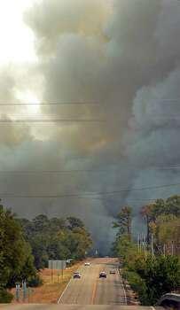 A wild fire flares up again along Highway 21 near Highway 95 on Tuesday, Sept. 6, 2011 in Bastrop, Texas. (AP Photo/Austin American-Statesman, Ralph Barrera) Photo: Ralph Barrera, Associated Press / Austin American-Statesman