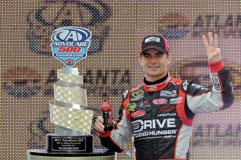 HAMPTON, GA - SEPTEMBER 06:  Jeff Gordon, driver of the #24 Drive to End Hunger Chevrolet, celebrates in victory lane after winning the NASCAR Sprint Cup Series AdvoCare 500 at Atlanta Motor Speedway on September 6, 2011 in Hampton, Georgia.  (Photo by John Harrelson/Getty Images for NASCAR) Photo: John Harrelson, Stringer / 2011 Getty Images