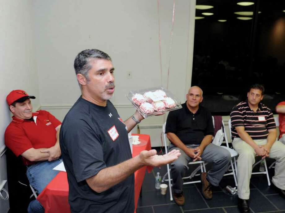 "Old Greenwich resident Gary Dell'Abate unveils the ""Cardinal Cupcake"" during the Cardinal Quarterback Club's annual Cardinal Kick-Off Party at the Montgomery Pinetum in Cos Cob Tuesday night, Sept. 6, 2011.  Dell'Abate said the cupcake is available at Crumbs Bake Shop at 48 West Putnam Ave. in Greenwich, and will also be sold during Greenwich High School varsity football home games with a portion of the proceeds going to the Quarterback Club.  Dell'Abate's son, Jackson, is a guard on the team. Photo: Bob Luckey / Greenwich Time"