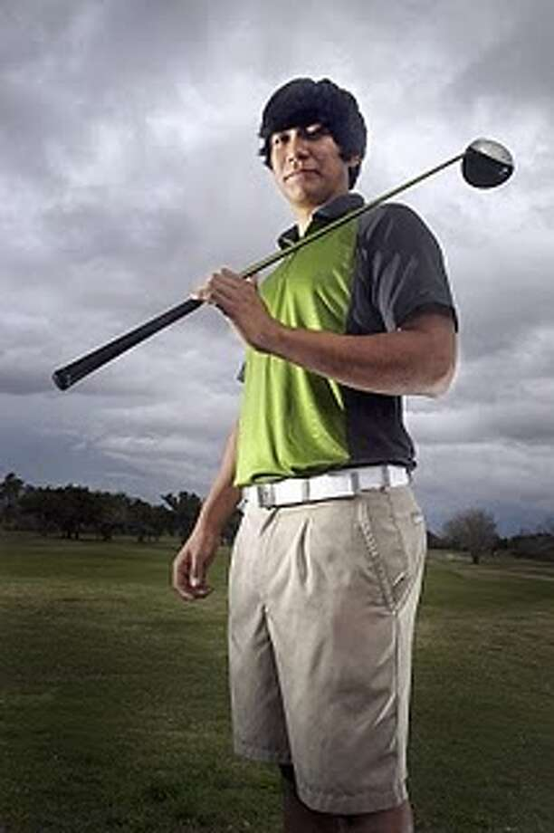 UH coach Jonathan Dismuke sees Roman Robledo as a good athlete who will develop into an excellent golfer. Photo: Handout