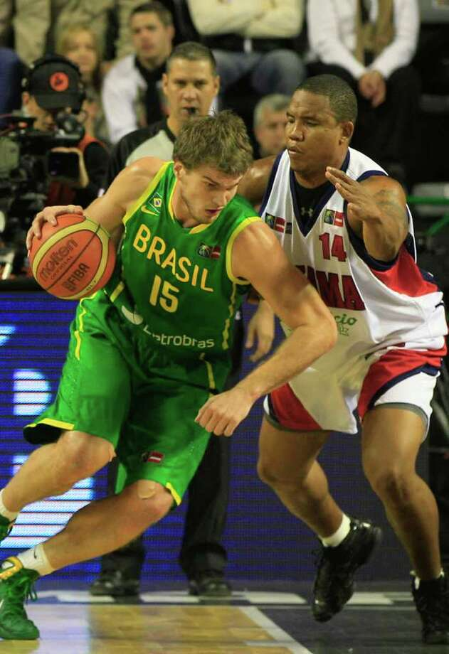 Brazil's Tiago Splitter, left, attempts to dribbles past Panama's Jaime Lloreda during a FIBA Americas Championship basketball game in Mar del Plata, Argentina, Tuesday, Sept. 6, 2011. The top two finishers of the tournament get an automatic berth in the 2012 London Olympics and the next three advance to the last-chance Olympic qualifier to be held in July 2012. Photo: Martin Mejia/Associated Press