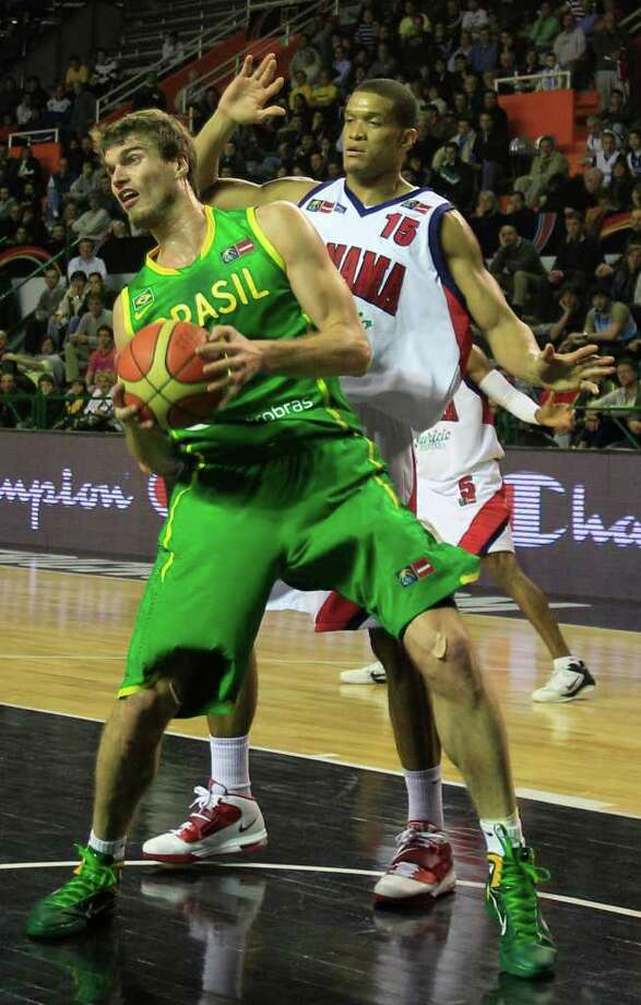 Brazil's Tiago Splitter, front, is challenged by Panama's Ruben Garces during a FIBA Americas Championship basketball game in Mar del Plata, Argentina, Tuesday, Sept. 6, 2011. The top two finishers of the tournament get an automatic berth in the 2012 London Olympics and the next three advance to the last-chance Olympic qualifier to be held in July 2012. Photo: Martin Mejia/Associated Press