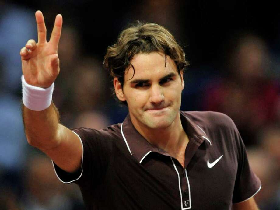 Switzerland's Roger Federer thanks the fans after winning against Belgium's Olivier Rochus their first round match at the Davidoff Swiss Indoors tennis tournament in Basel, Switzerland, Monday, Nov. 2, 2009. (AP Photo/Keystone/Georgios Kefalas) Photo: GEORGIOS KEFALAS / KEYSTONE