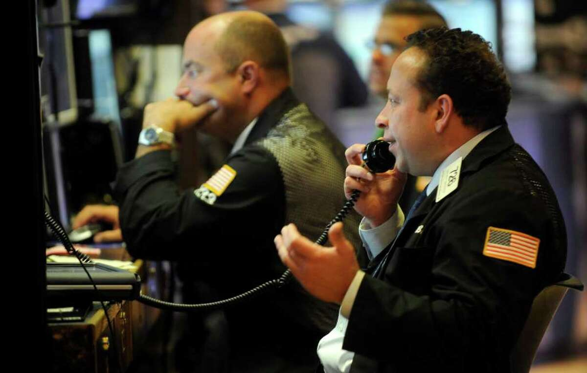Traders work on the floor of the New York Stock Exchange, Tuesday, Sept. 6, 2011, in New York. (AP Photo/Henny Ray Abrams)