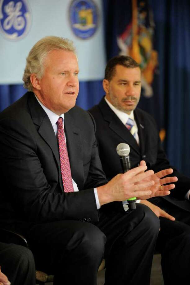 Jeff Immelt, Chairman and CEO of GE(l) shares a light moment with Governor David Paterson(r) at the announcement of a new $100 M battery fabrication plant that will be built in this area which will also bring with it 350 new jobs. (Skip Dickstein / Times Union) Photo: SKIP DICKSTEIN / 00003844A