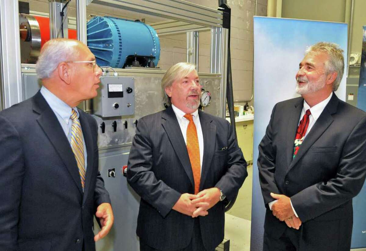 From left, US Rep. Paul Tonko, NYSERDA's Frank Murray and Ener-G-Rotors CEO Michael Newell during a news conference at Ener-G-Rotors in Rotterdam Tuesday Sept. 6, 2011. (John Carl D'Annibale / Times Union)