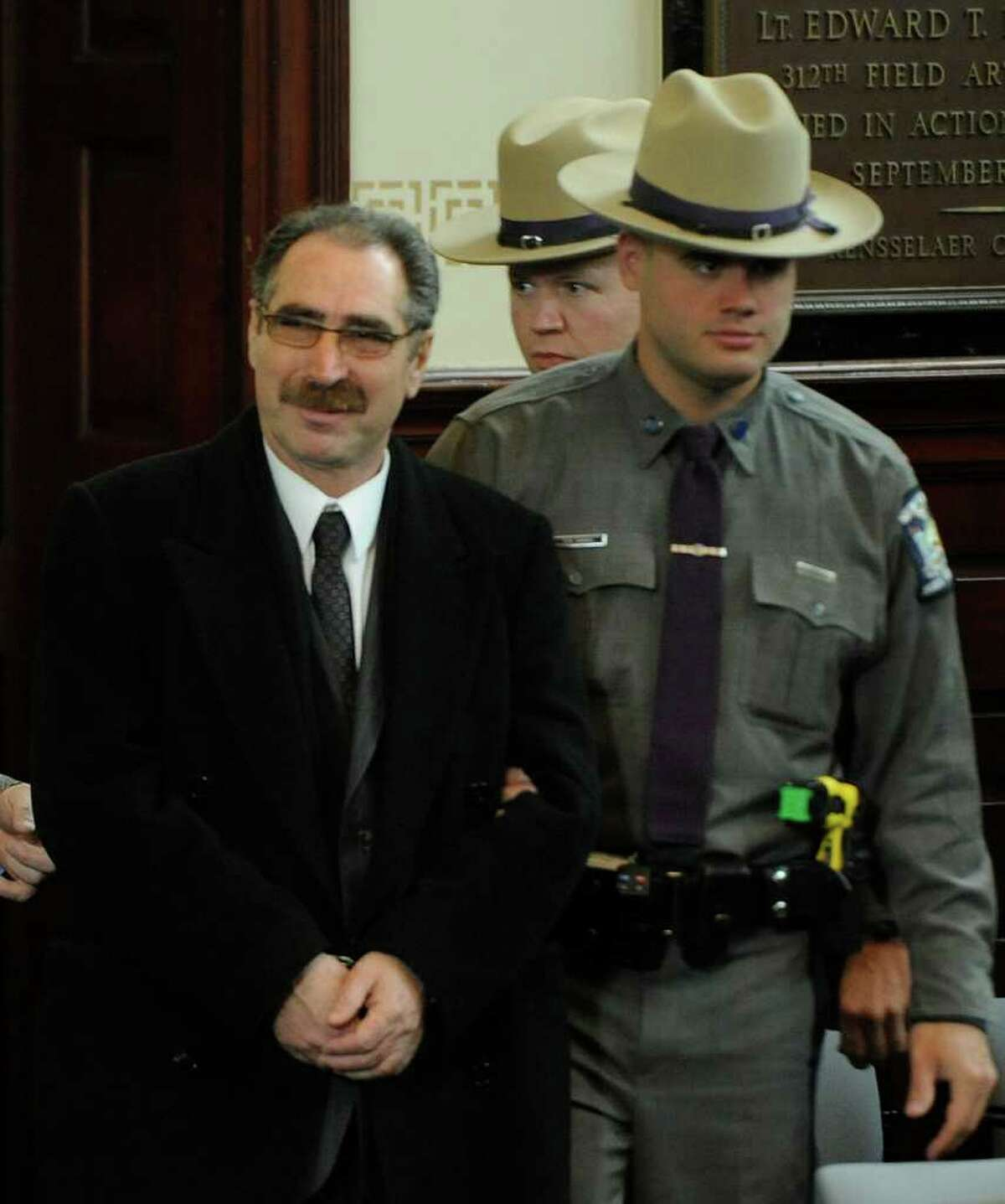 Michael LaPorto is lead in to the courtroom in the Rensselaer County Courthouse in Troy January 28, 2011 to face charges of alleged voter fraud after a Grand Jury handed up sealed indictments naming him and Edward McDonough Jr. (Skip Dickstein / Times Union)