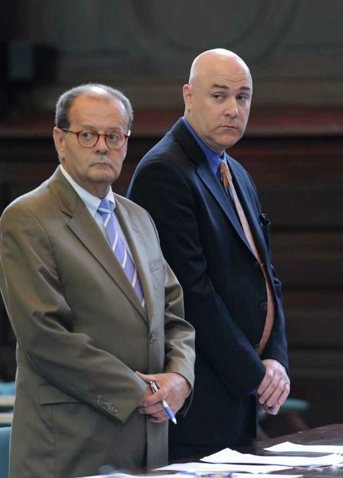 Former Troy City Clerk William A. McInerney, right, a Democrat, admitted Friday that he signed a voter's signature to a Working Families Party absentee ballot in 2009 to steer the vote to his party's candidate in front of Judge George Pulver in Rensselaer County Court in Troy, N.Y. Aug 26, 2011. Standing with McInerney is his attorney James Long. (Skip Dickstein / Times Union)